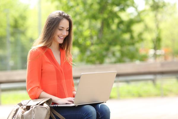 Happy girl using laptop Stock Photo 02