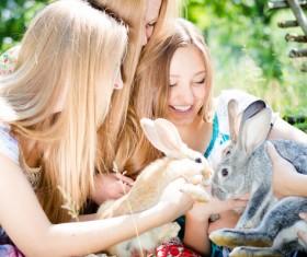 Happy girls and bunnies Stock Photo