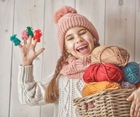 Happy little girl holding knitwear Stock Photo 01