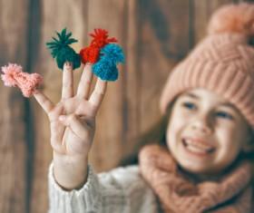 Happy little girl holding knitwear Stock Photo 02
