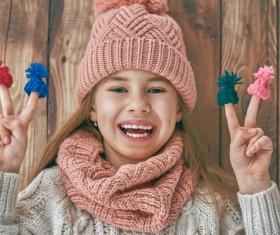 Happy little girl holding knitwear Stock Photo 03