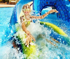 Happy little girl playing in water amusement park Stock Photo 01