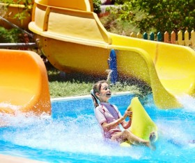 Happy little girl playing in water amusement park Stock Photo 04