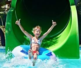 Happy little girl playing in water amusement park Stock Photo 05