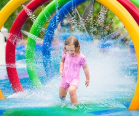 Happy little girl playing in water amusement park Stock Photo 06