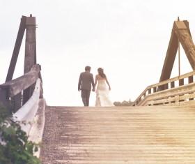 Happy marriage couple walking on ancient bridge Stock Photo