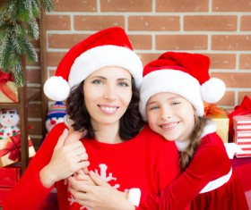 Happy mother and daughter wearing Christmas costume Stock Photo