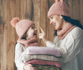 Happy mother and daughter wearing knitted sweaters Stock Photo