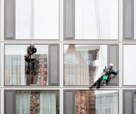 High-rise building exterior cleaning spider-man Stock Photo