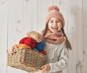 Holding the little girl with a basket of wool Stock Photo
