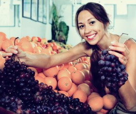 Housewife buy grapes Stock Photo