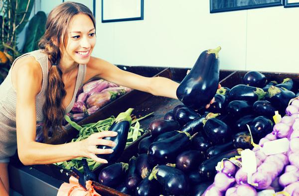 Housewife buys eggplant Stock Photo