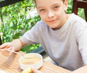 Little boy eating lunch Stock Photo