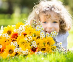 Little girl and flowers Stock Photo