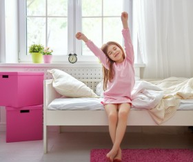 Little girl getting up Stock Photo