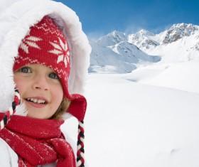 Little girl having fun in ski resort Stock Photo