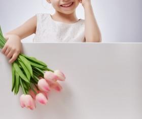 Little girl holding flowers Stock Photo