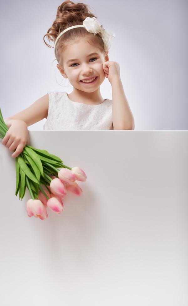 Portrait of girl holding flower - Stock Photo - Dissolve