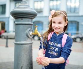 Little girl washing hands Stock Photo