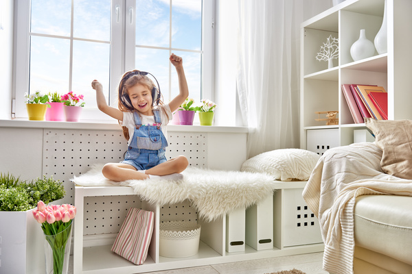 Little girl waving his arms while listening to music Stock Photo