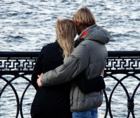 Lovers hugging each other on the bridge Stock Photo