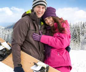 Lovers nestled in the ski area Stock Photo
