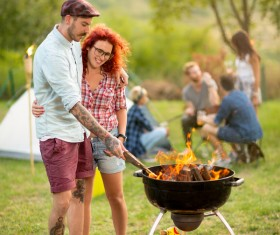 Lovers standing by the campfire Stock Photo
