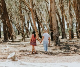 Lovers walking in the woods Stock Photo