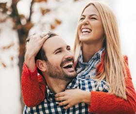 Man carrying girlfriend happy Stock Photo