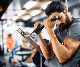 Man exercising Musculus biceps brachii Stock Photo