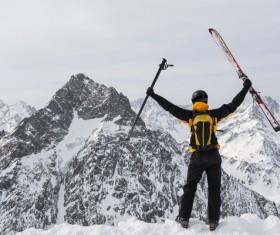 Man holding up ski equipment Stock Photo