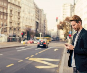 Man playing cell phone Stock Photo