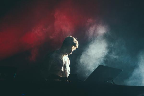Man playing music on smoke dark stage Stock Photo