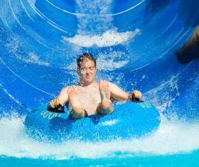 Man playing water slide Stock Photo