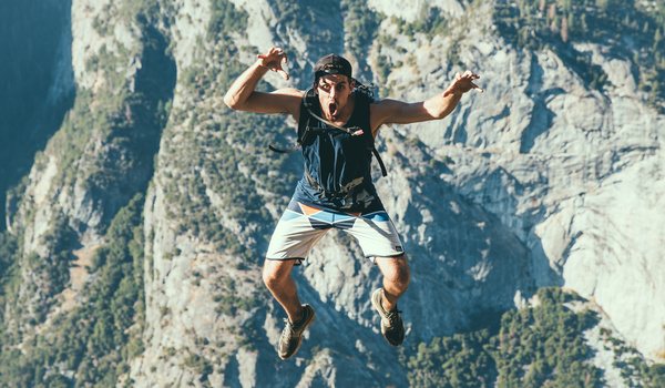 Man posing with extreme emotion at altitude Stock Photo