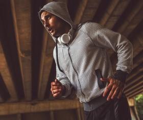 Man running with headphones Stock Photo