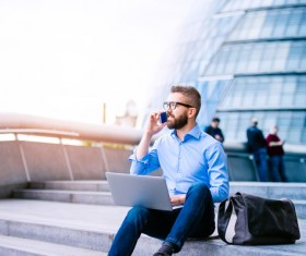 Man sitting on the steps talking on the phone Stock Photo