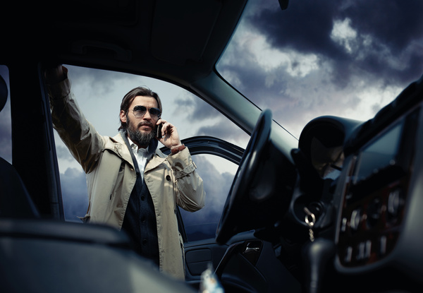 Man standing next to the car Stock Photo