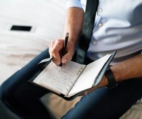 Man writing notes Stock Photo