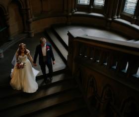 Marriage couple walking on staircase Stock Photo