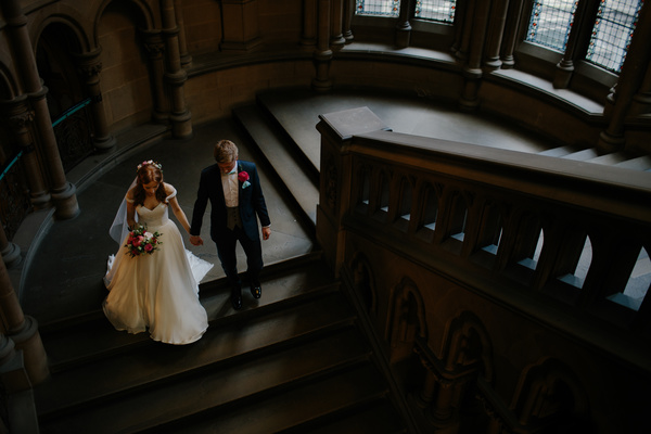 Marriage couple walking on staircase Stock Photo