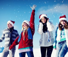 Men and women wearing Christmas hats at Ski Field Stock Photo