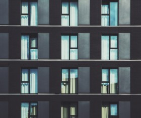 Modern apartment building with glass windows Stock Photo