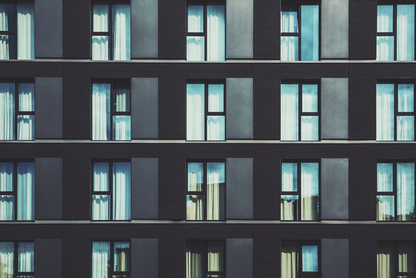 Modern apartment building with glass windows Stock Photo ...