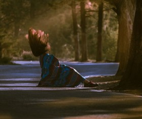 Moment snap of fallen woman on road Stock Photo