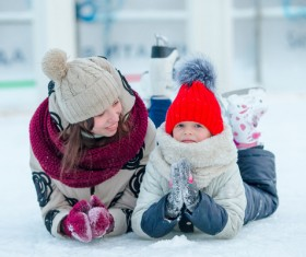 Mother and child lying on the ice Stock Photo