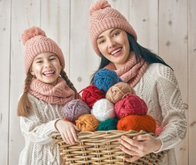 Mother and daughter holding a basket of wool Stock Photo 01