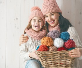 Mother and daughter holding a basket of wool Stock Photo 02