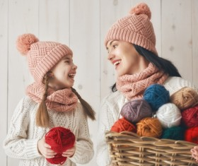 Mother and daughter holding a basket of wool Stock Photo 03