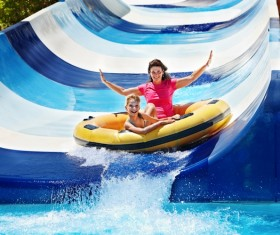 Mother and daughter playing water slides Stock Photo